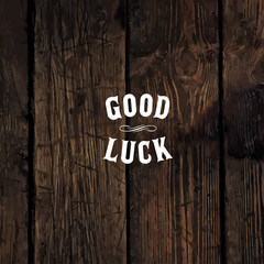 "Wild west styled ""Good Luck"" message on wooden board"