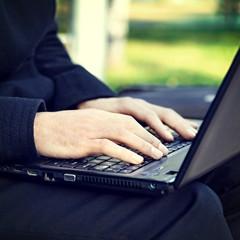 Hands on the Laptop closeup