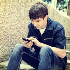 Teenager with Cellphone outdoor