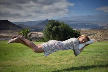 Levitation girl on the pillow
