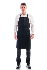 Full length shot of young chef or waiter posing isolated