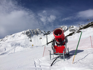 Modern red snow cannon in sunny day