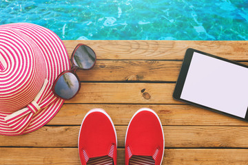Summer holiday vacation essential objects on wooden deck