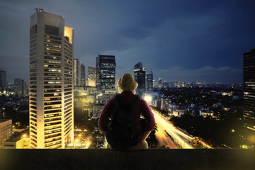 Traveller Sitting On The Top Of Building