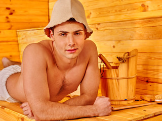 Man in hat  at sauna.