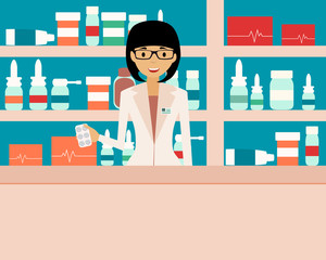 Happy female pharmacist standing in a  drugstore