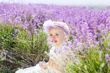 Cute little child girl in lavender field