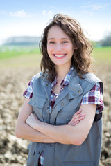 Portrait of a young attractive farmer in fields