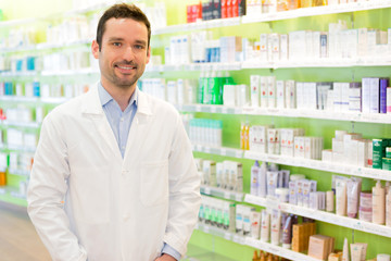 Portrait of an attractive pharmacist at work