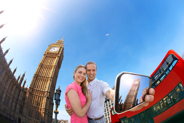 couple taking selfie against Big Ben in London, England