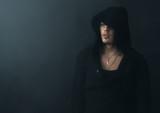 man in  black hoodie upset
