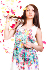 Pretty young woman in a bright dress