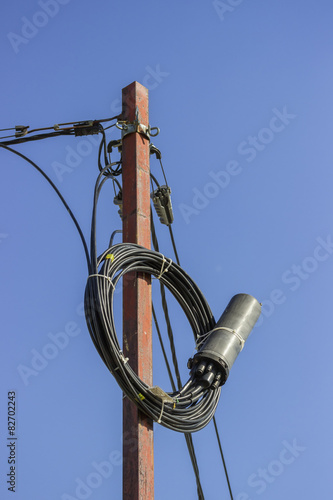 poster of Roll of fibre optic cable with splice enclosure hanging
