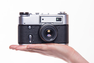 Classic 35mm photo camera on hand