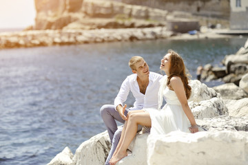 young couple bride and groom smiling near sea, Naples, Italy