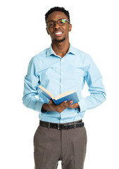 Happy african american college student with book in his hands st
