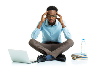 African american college student in stress sitting with laptop,
