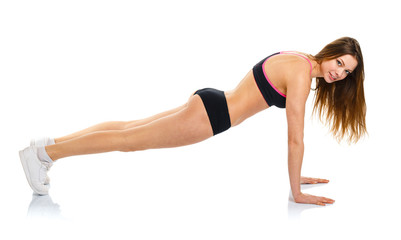 Happy athletic woman doing sport exercise, isolated on white