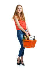 Happy young woman holding a basket full of healthy food on white