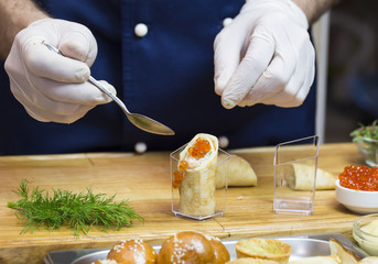 cook prepares canapes in the kitchen at the restaurant
