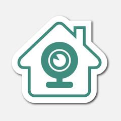 Logo maison et caméra.