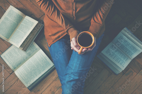 girl having a break with cup of fresh coffee after reading books - 82711893