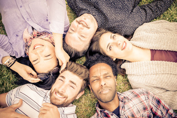 group of friends lying on the grass