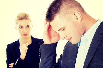Businesswoman reprimend her partner