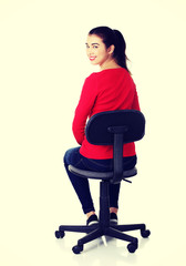 Happy woman sitting on a chair