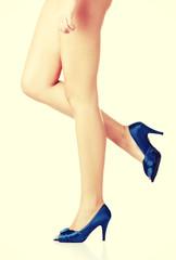 Naked woman legs in heels