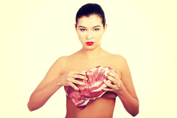 Naked woman holding beef