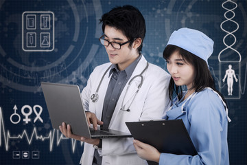 Young male doctor and medical assistant