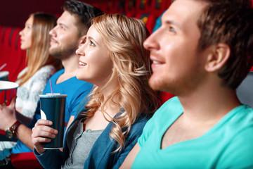 Woman with coke in cinema between viewer