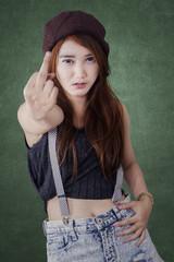 Teenage girl girl showing middle finge