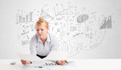 Business woman at desk with hand drawn charts
