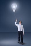 Male entrepreneur pull a lamp