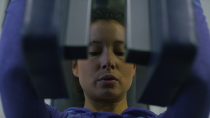 Young attractive woman working out in the gym