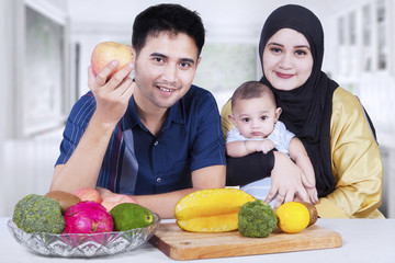 Happy family with fresh fruit at home