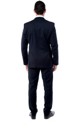 Back pose of male entrepreneur