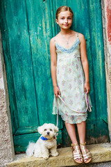 Lovely fashion girl with maltese dog