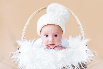cute newborn baby in knitted cap