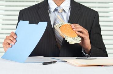Greedy executive eating money