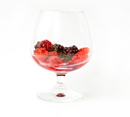 healthy mixed berries fruit in glass. On white background