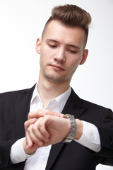 businessman in a suit looking at his watch