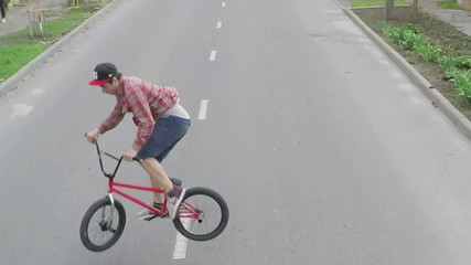 The guy doing tricks on a bicycle - aerial survey