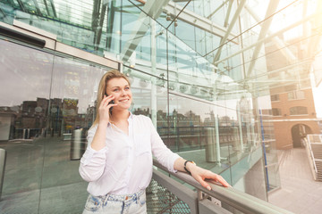 Young woman talking on mobile phone with a glazed background