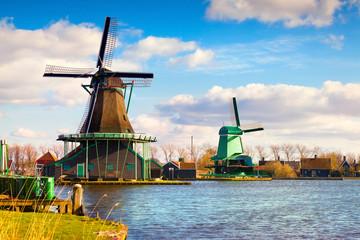 Authentic Zaandam mills on the water channel in Zaanstad willage