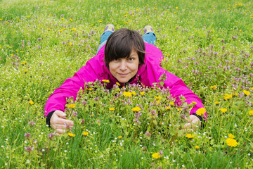 Cheerful woman on a flower meadow