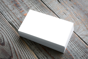 Business cards on wood table ( with separate layer clipping path
