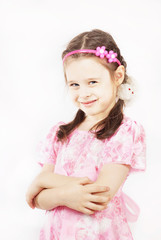 Little pretty girl wearing beautiful pink dress is smiling